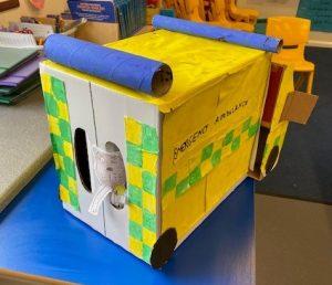 Back of large yellow handmade cardboard ambulance