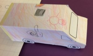 Small paper ambulance coloured in with bright colours