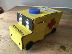 Small handmade yellow cardboard ambulance