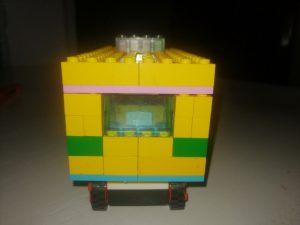 Back of small ambulance made from yellow building bricks